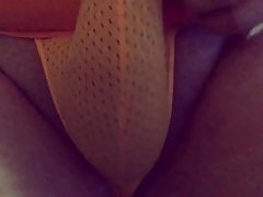 Playing with my bulge in a tiny orange mesh thong